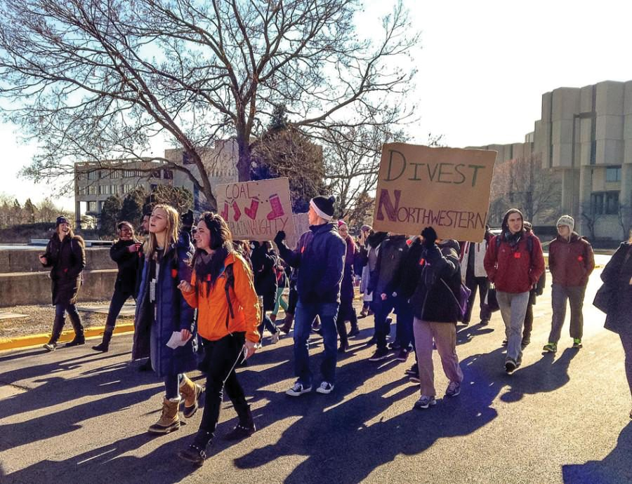 Students march to a Board of Trustees meeting in 2014 to ask Northwestern to divest its endowment funds from the coal industry. After four years of debates, discussion and waiting, Fossil Free Northwestern wants to see concrete action on the University's divestment from nonrenewable energy.