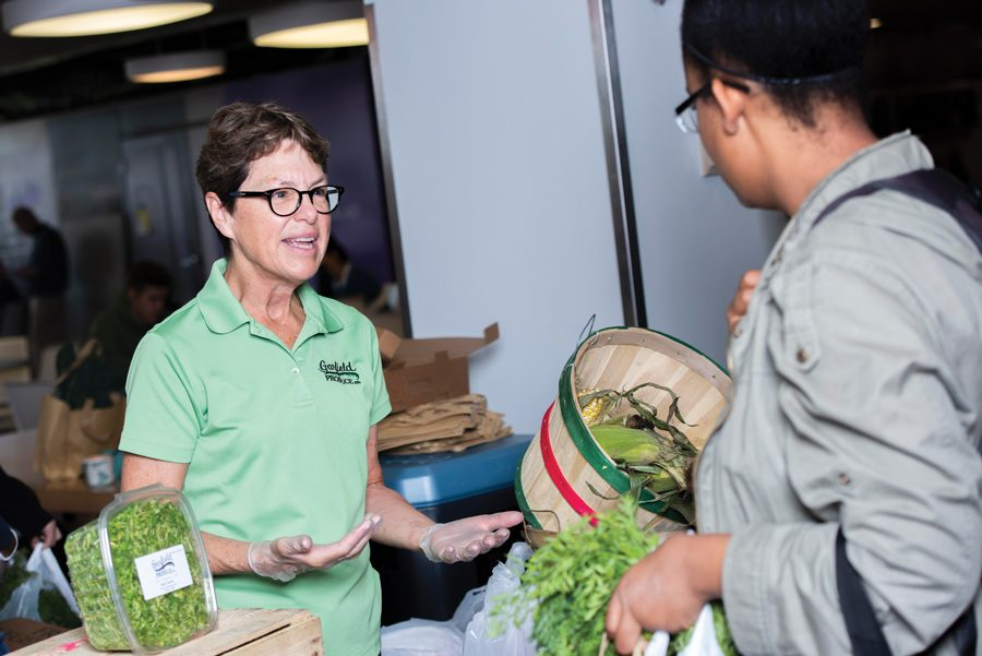 Garfield Produce Company co-founder Judy Thomas speaks to students at a January event held by Compass Group. The company started supplying NU Dining halls with microgreens through Compass in September 2018