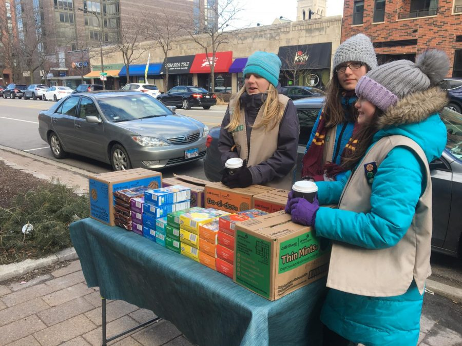 Girl Scouts stand outside Peet's Coffee, 1622 Chicago Ave., to sell cookies. The girls are selling to raise money for a service trip in Costa Rica during the summer of 2020