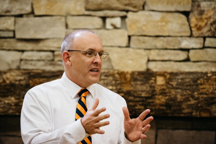 Mayor Steve Hagerty speaks at a town hall meeting Monday. Community members raised concern about how the city plans to finance the Robert Crown Community Center project.