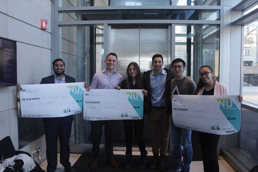 Improve NU winners stand with their checks at The Block Museum of Art. McCormick sophomore Lilian de Souza won the competition with her idea, NPowerU.
