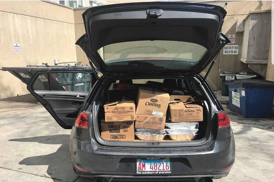 Boxes+of+food+Campus+Kitchens+distributes+to+food-insecure+Evanston+residents.+The+organization+can+no+longer+use+University+vans%2C+and+now+drives+Zipcars+or+personal+vehicles+to+transport+the+food+around+Evanston.