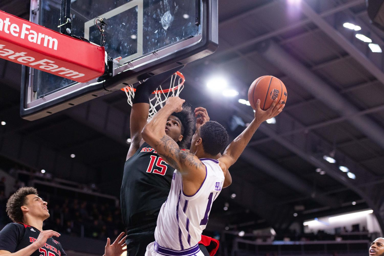 Ryan Taylor puts up a layup. Northwestern missed a lot of shots Wednesday.