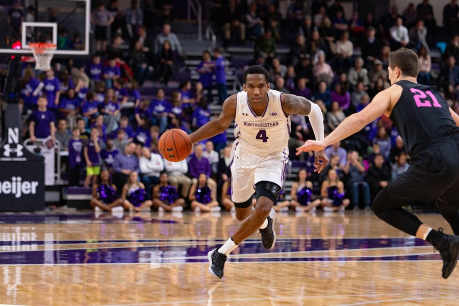 Vic Law dribbles the ball. The senior forward leads Northwestern in scoring heading into Sunday's game.
