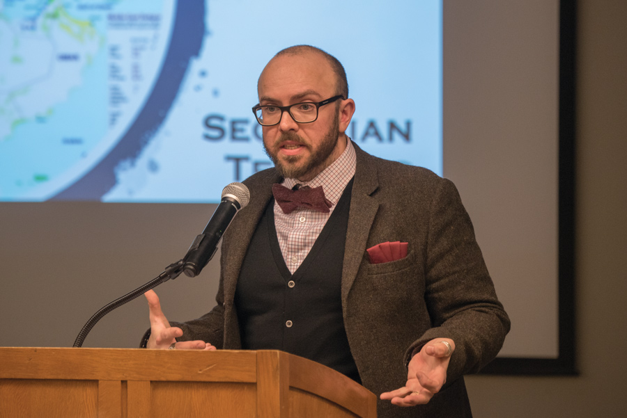 Simon Mabon speaks to a crowd of about 90 on Monday night. Mabon evaluated 30 years of history to deconstruct relations between Saudi Arabia and Iran