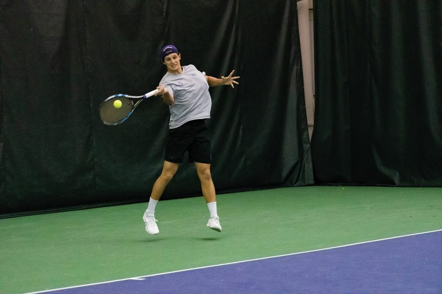 Chris Ephron hits a forehand. The junior helped lead Northwestern back to a .500 record.