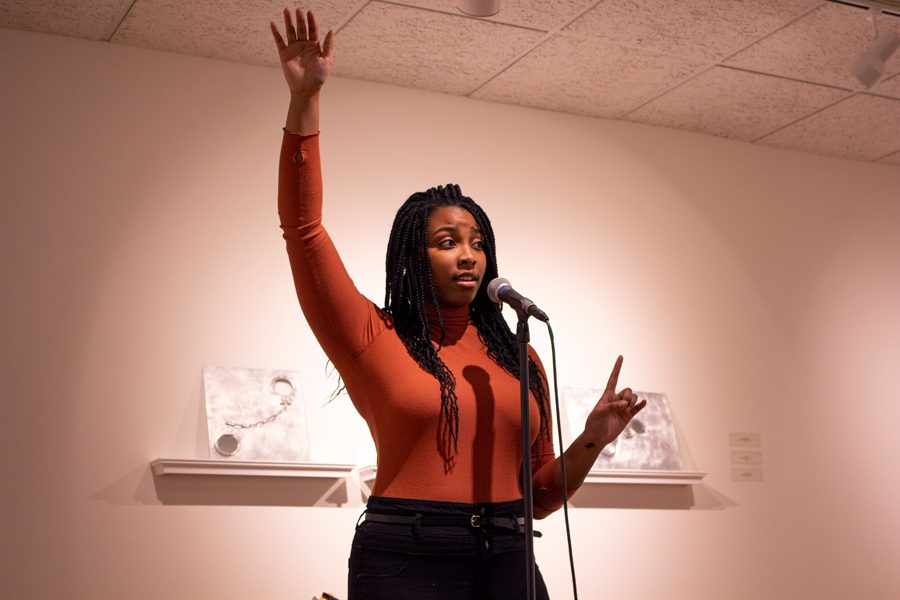 Kourtni+McNeil%2C+who+helped+organize+the+open+mic+event%2C+delivers+one+of+her+original+poems.+Nine+other+students+performed+at+the+open+mic%2C+which+was+held+to+raise+awareness+of+mental+illness+on+campus.+