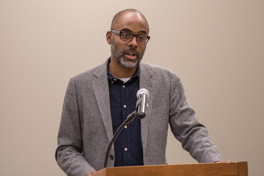 Brett Gadsden speaks at an event at Evanston Public Library. Gadsden explained the influence of black voters in electing John F. Kennedy in 1960.