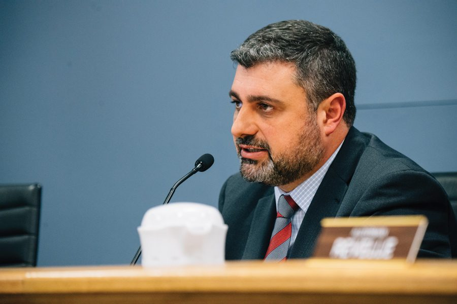 Ald. Thomas Suffredin speaks at City Council. Suffredin listened to concerns from his constituents about a proposal for 2626 Reese Ave.
