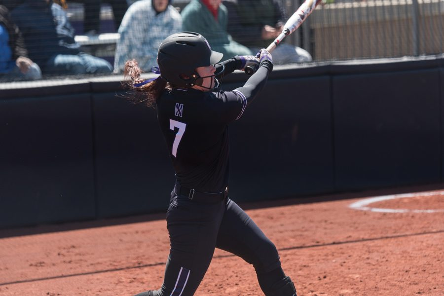 Morgan+Nelson+takes+a+swing.+The+senior+had+five+hits%2C+including+a+homer%2C+to+help+NU+to+a+4-1+record+this+weekend.