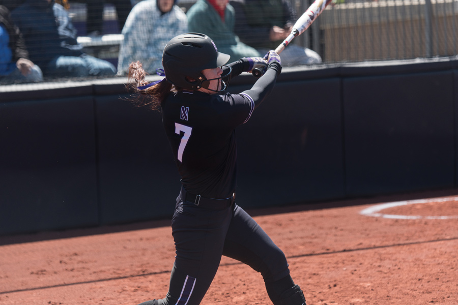 Morgan Nelson takes a swing. The senior had five hits, including a homer, to help NU to a 4-1 record this weekend.