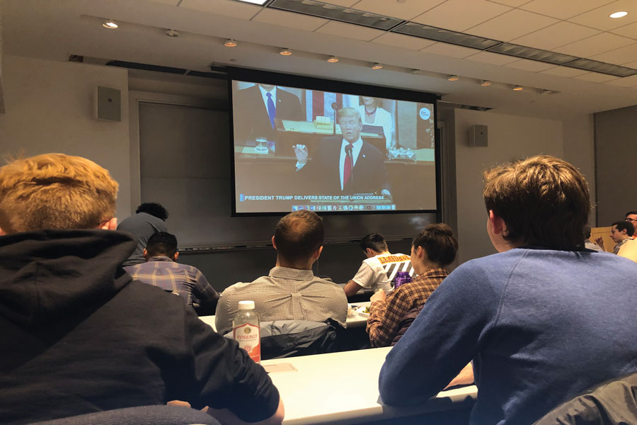 Students watch President Donald Trump's State of the Union speech at McCormick Foundation Center. Weinberg junior Dominic Bayer said Trump was able to focus more on political issues rather than personal attacks during his speech