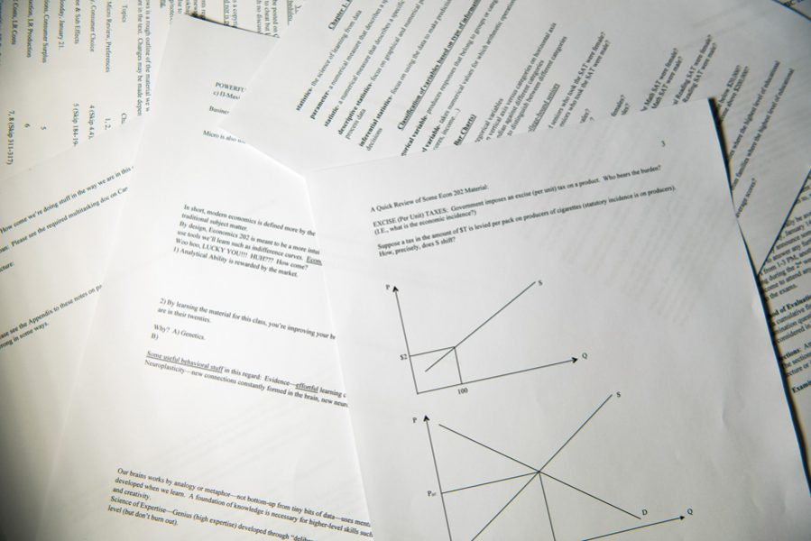 A stack of notes required for statistics and economics classes. Kathia Benitez, director of sustainNU, said her office is working with faculty to reduce paper waste in classrooms.