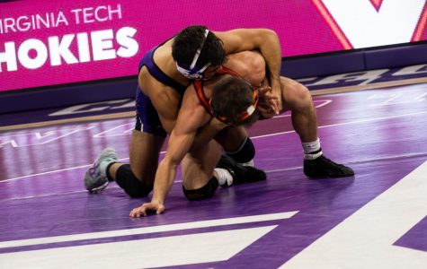 Sebastian Rivera wrestles with an opponent. The sophomore lost his first match of the season this weekend