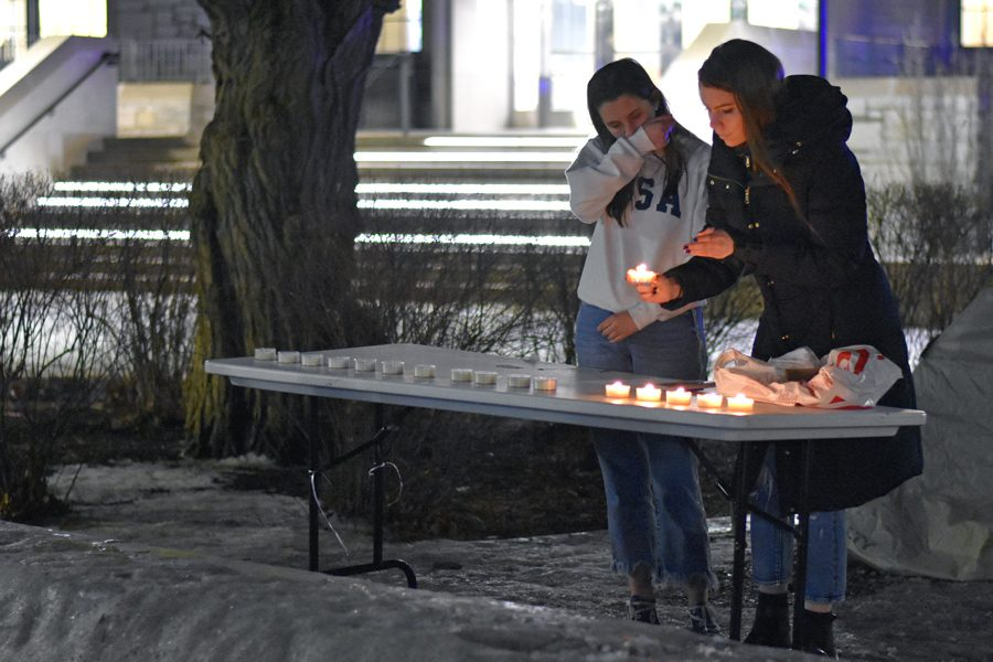 Arianna Staton and Avery Zieper light 17 candles at a Thursday vigil commemorating last year's school shooting in Parkland, Florida. Staton said she organized the event Wednesday when she realized no one else had planned anything.