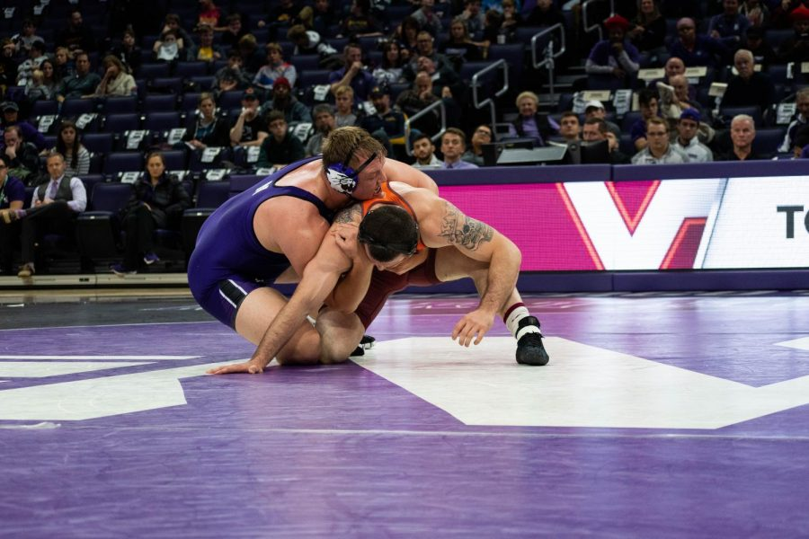 Conan Jennings spars with an opponent. On Friday, NU could beat Illinois for the first time in his career.