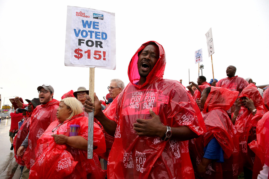 Hundreds of protesters rally for a $15 an hour minimum wage on Sept. 4, 2014 in Chicago. On Tuesday, Gov. J.B. Pritzker signed a bill to increase the minimum wage in Illinois to $15 by 2025.
