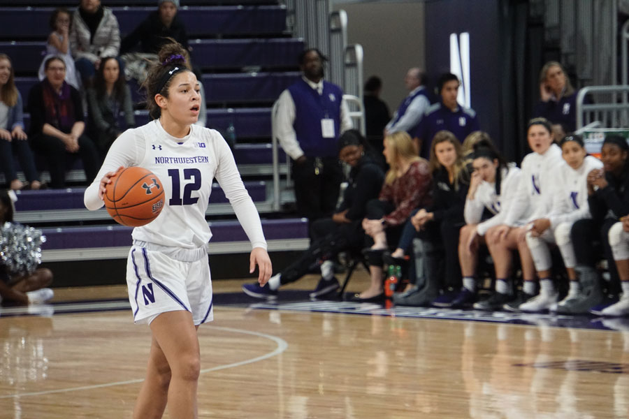 Veronica Burton dribbles the ball. The freshman guard scored 15 points in the Cats' WNIT quarterfinal win on Saturday.