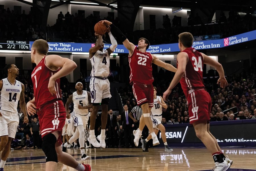 Vic+Law+gets+his+shot+blocked.+He+scored+24+points+in+Saturday%E2%80%99s+loss+to+Wisconsin.