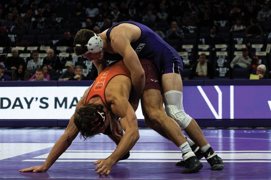 Ryan Deakin wrestles an opponent. The sophomore won his bout Sunday against Ohio State's Ke-Shawn Hayes, but the Wildcats came up short.