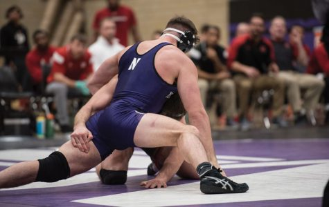 Zack Chakonis wrestles with an opponent. The New Jersey native was victorious in a major win for NU.