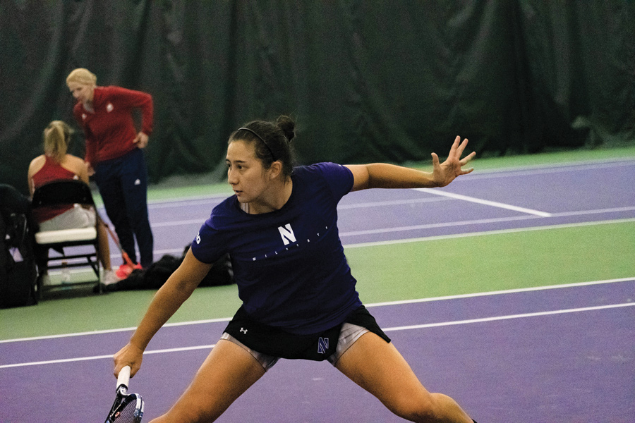 Caroline Pozo hits a backhand. The Wildcats split their two matches this weekend
