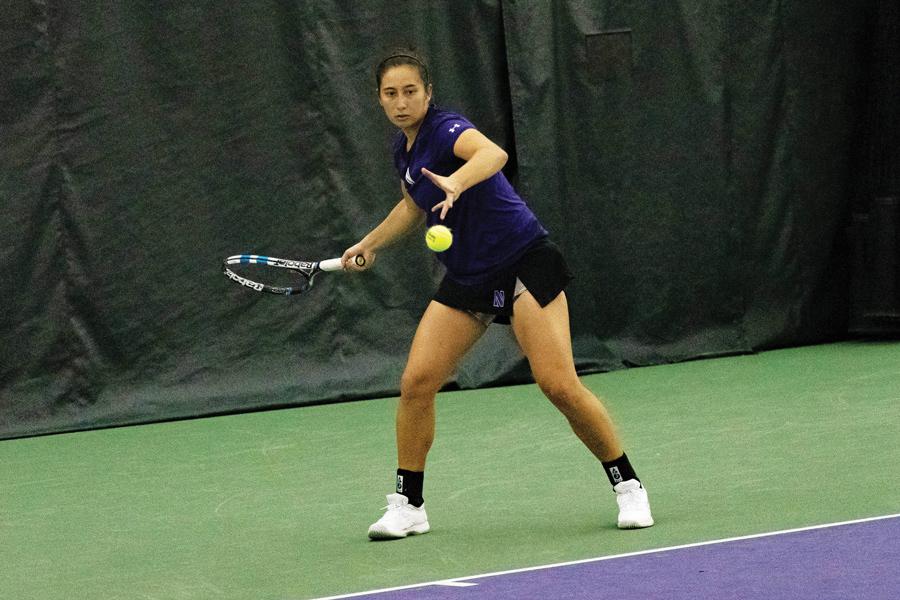 Lee Orr hits a forehand. The Wildcats split their two results this weekend