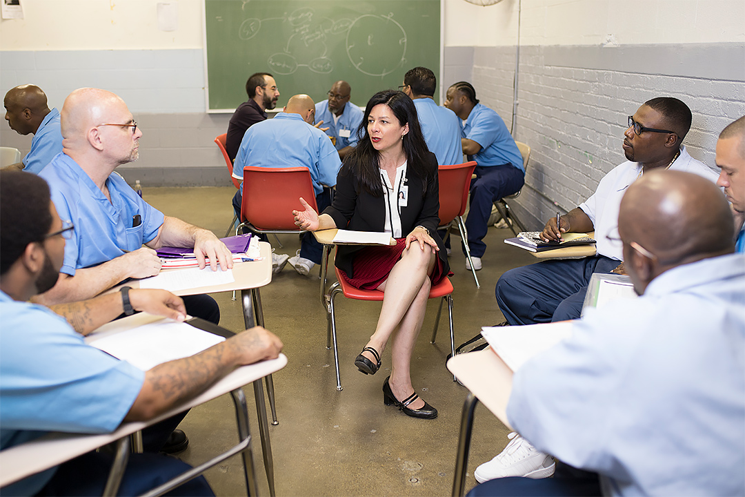 """Philosophy Prof. Jennifer Lackey leads a class at Stateville Correctional Center. Lackey and One Book One Northwestern volunteers visited the prison Wednesday to lead a discussion with inmates on """"The Handmaid's Tale."""""""