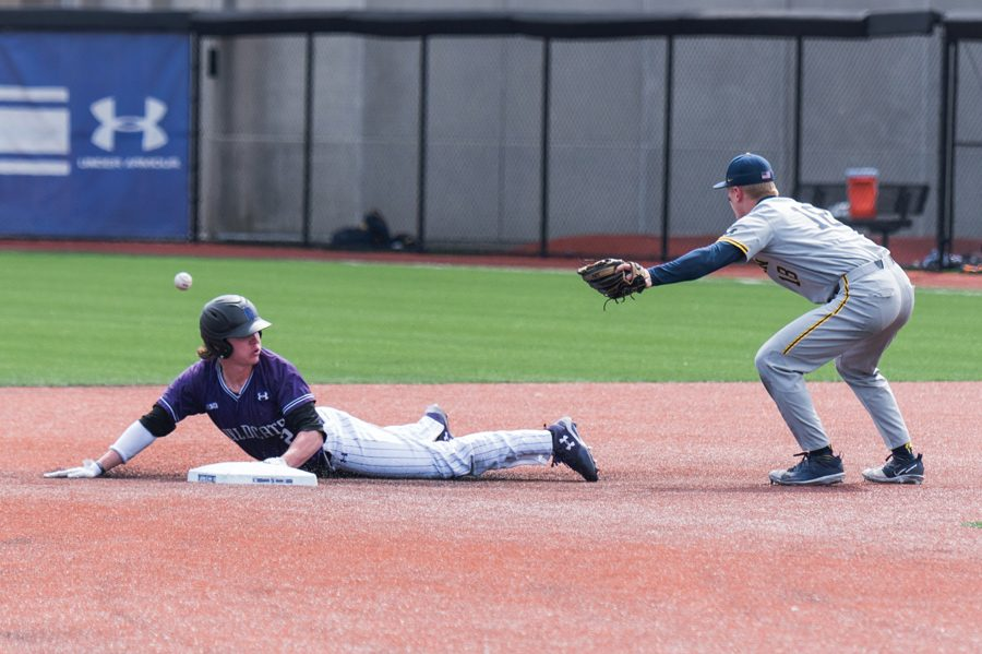 Jack Dunn slides into second base. The senior is hitting .381 for the season
