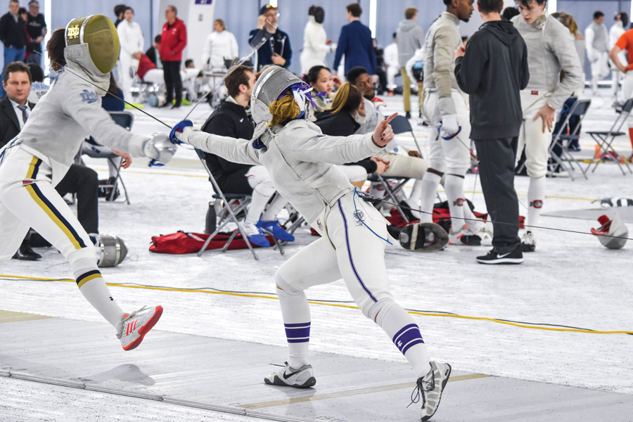 A Northwestern fencer clashes with an opponent. The Wildcats will fence for the chance at an NCAA Championships berth