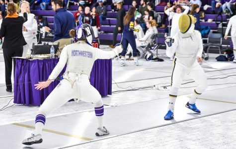 A Northwestern fencer faces off with her opponent. The Wildcats will send 5 fencers to the NCAA Championships.
