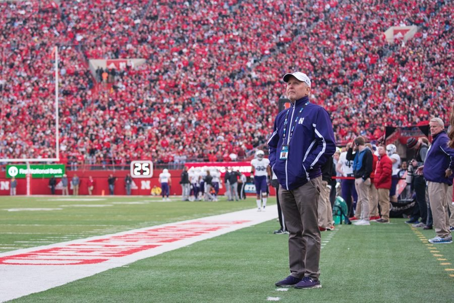 Morton Schapiro watches a football game. He'll be leading the search committee to hire the new Big Ten commissioner