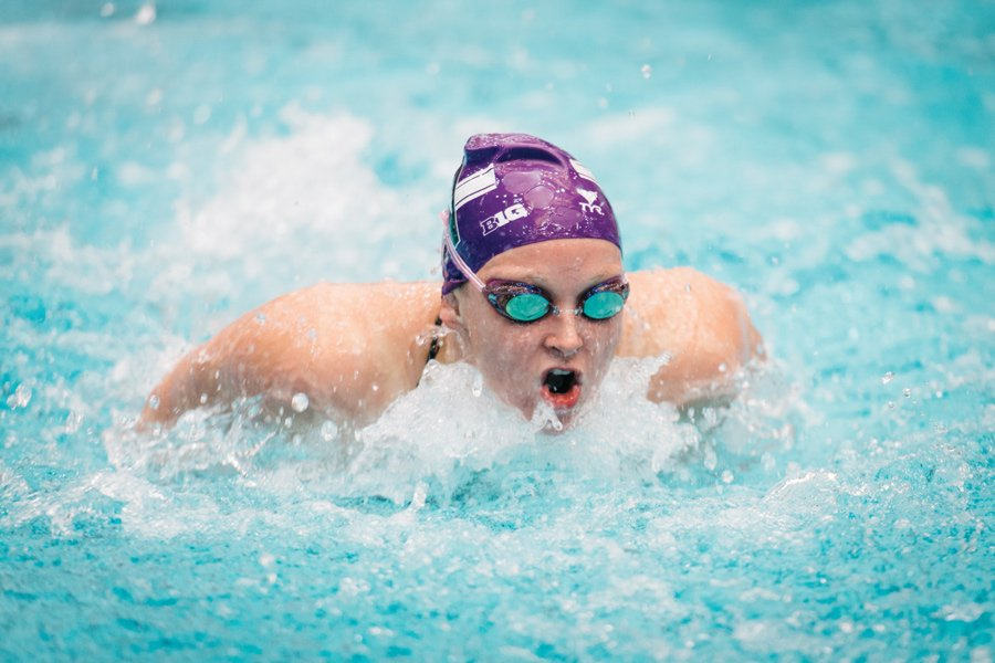 A Northwestern swimmer does a lap in the pool. The Wildcats finished ninth in the conference
