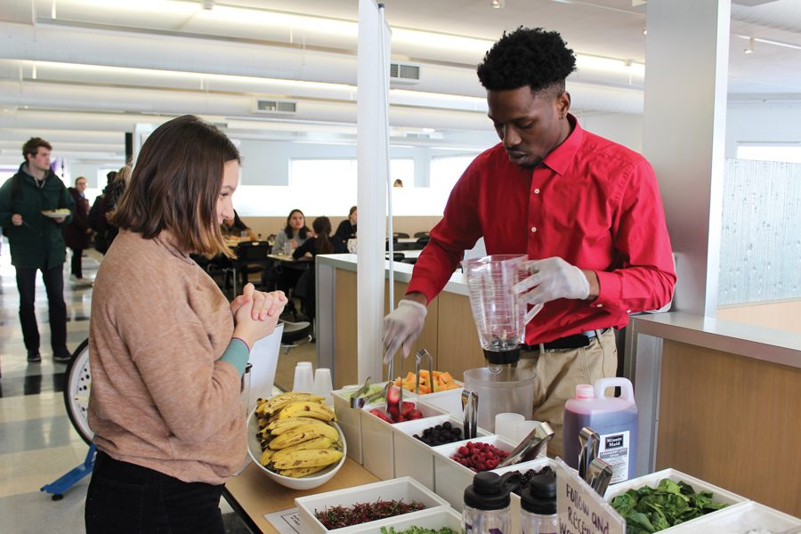 Weinberg first-year Irem Özturan makes a smoothie at a National Nutrition Month event with the help of Gerald Daye Jr., a Northwestern Dining marketing intern. NU Dining and Compass will continue to provide similar programming throughout March.