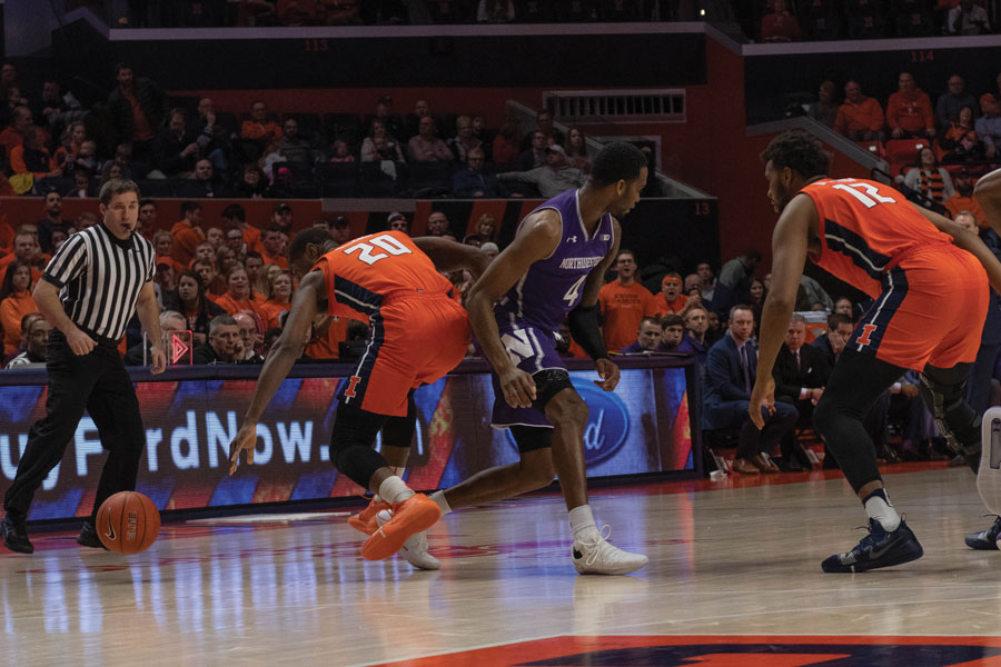 Vic Law loses the ball. The Fighting Illini pressed Northwestern throughout the game.
