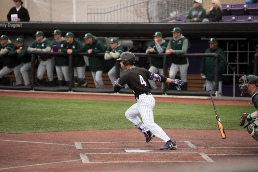 Alex+Erro+takes+off+for+first+base.+Northwestern+won+its+home+opener+Tuesday.