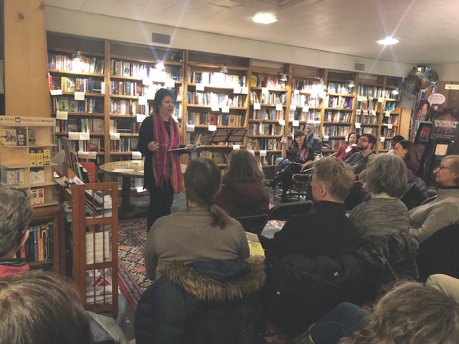 """Nina Barrett, the owner of Bookends & Beginnings, introduces a Tuesday event titled """"Literary Appetizers: A Taste of Works in Progress."""" The event featured 10 writers, poets and podcasters who shared their pieces they have not yet finished."""