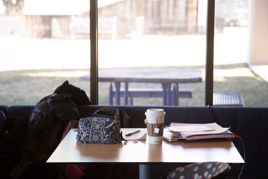 "A student's belongings sit unattended in Norbucks. The question, ""Watch my stuff?"" is an easy way for students to feel safe leaving their things behind while running out."