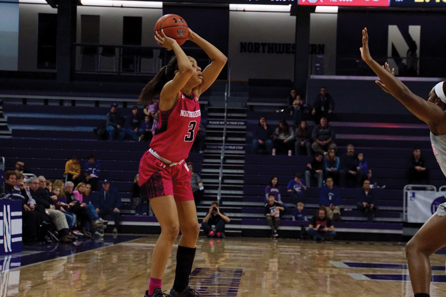 Sydney Wood looks to pass. The freshman forward started again for the Cats on Sunday.