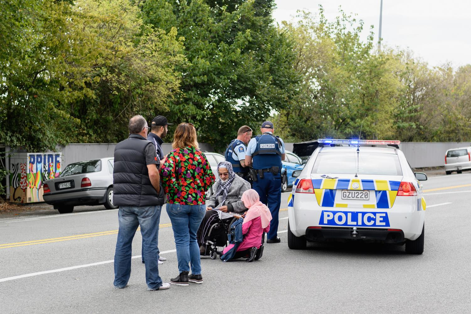 Members of the public react in front of the Masjd Al Noor Mosque as they fear for their relatives on March 15, 2019 in Christchurch, New Zealand. 49 people have been confirmed dead and more than 20 are injured following attacks at two mosques in Christchurch.