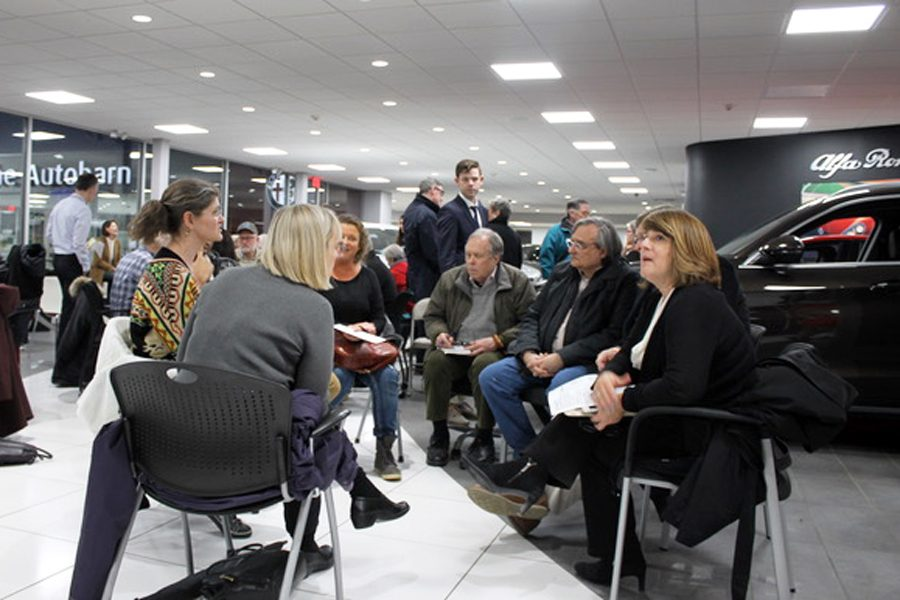 Evanston community members break into small groups to brainstorm and discuss changes to the Chicago Avenue streetfront. Residents expressed concern with traffic and building heights.