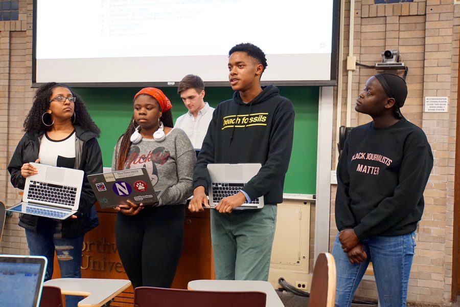 From left to right: Meron Amariw, Soteria Reid, Christian Wade and Emma Evans discuss a resolution demanding the University condemn recent racist incidents on campus during ASG Senate.
