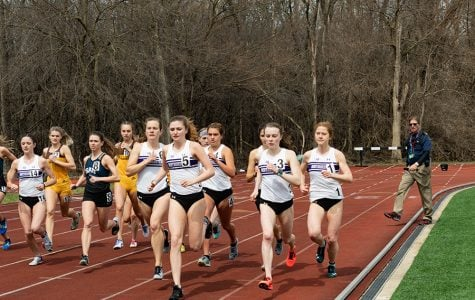 Sarah Nicholson leads a pack of runners. The junior ran a season-best time in the 10,000-meter race at the Mt. Sac Relays on Thursday.