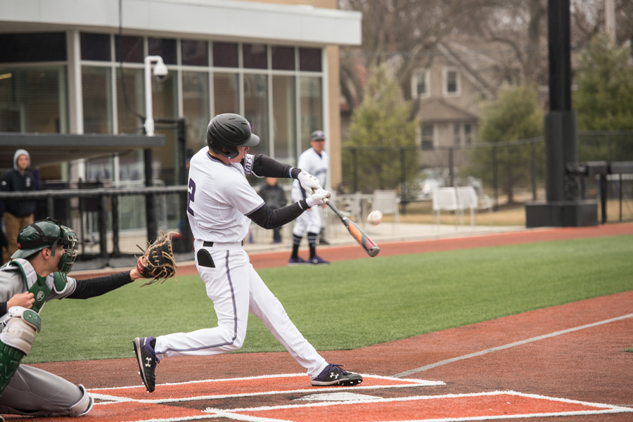 Jack Dunn swings the ball. The senior collected his 200th career hit in Tuesday's win over Chicago State.