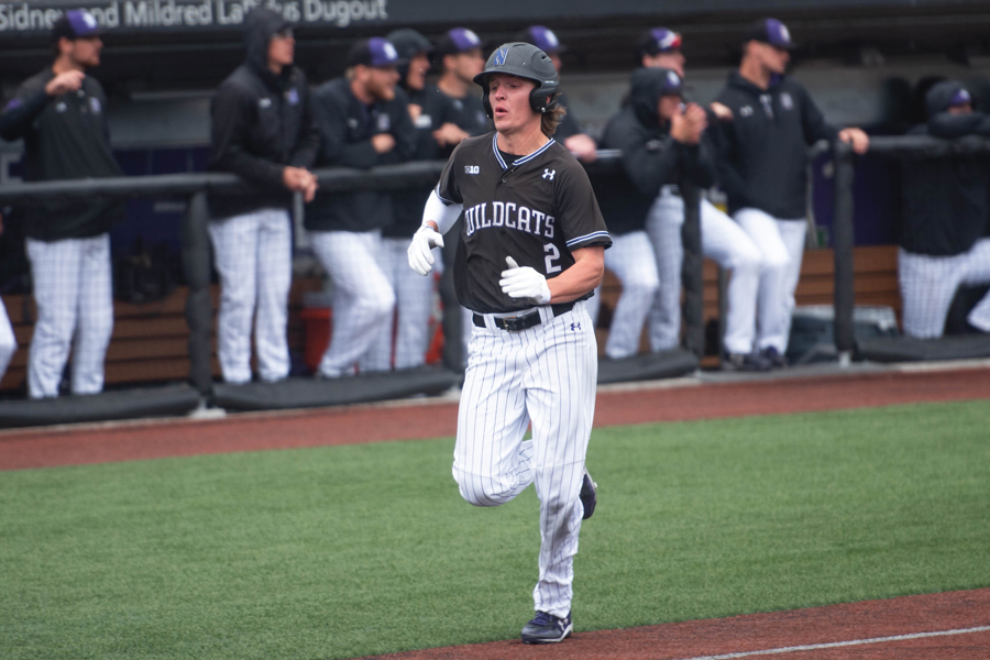 Jack Dunn runs into home plate. The senior shortstop had seven hits over the weekend.