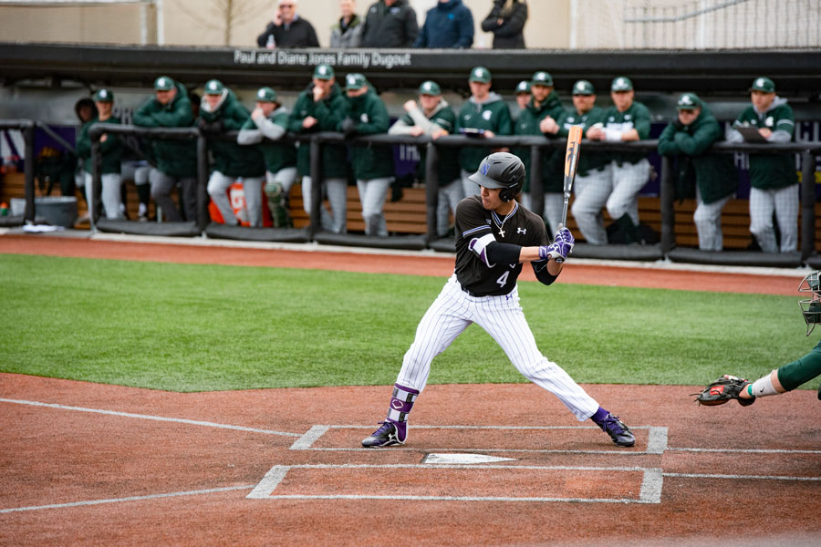 Alex Erro prepares to swing. The junior is one of four remaining starters from NU's last trip to Ann Arbor during its 2017 Big Ten Tournament run.