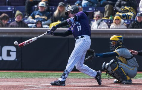 Leo Kaplan hits the ball. The junior left fielder hit a home run in NU's win over Illinois-Chicago on Tuesday.