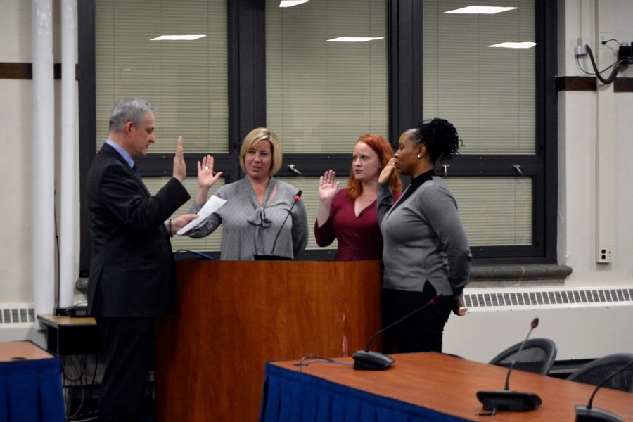 Newly elected board members Stephanie Teterycz, Elizabeth Rolewicz and Monique Parsons take the oath of office. The three women won the April 2 election with more than 20 percent of the votes each.
