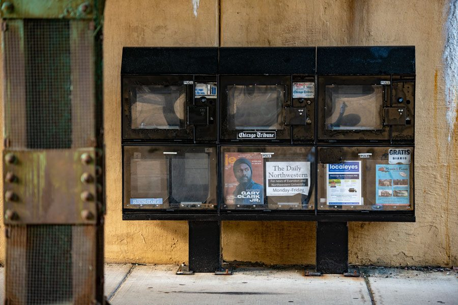A+newspaper+vending+machine+under+an+%22L%22+bridge+in+downtown+Evanston.+Local+Newspaper+struggle+to+stay+afloat%2C+but+Evanston+newspapers+remain+strong.
