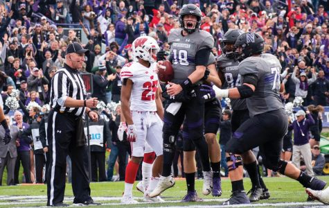 Clayton Thorson celebrates with his teammates after a score in a 2018 game. The quarterback was selected by the Philadelphia Eagles in this weekend's NFL Draft.